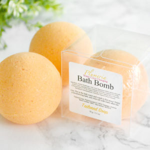 Orange Water Color Changing Plumeria Scented Bath Bomb by Tailored Soap