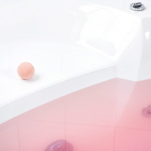 Red Water Color Changing Black Raspberry Vanilla Scented Bath Bomb by Tailored Soap in use