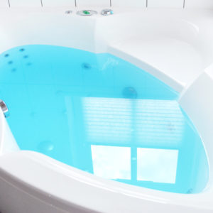 Blue Water Color Changing Seashore Bath Bomb by Tailored Soap in use