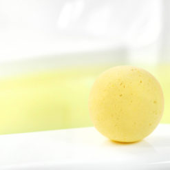 Yellow Water Color Changing Southern Peaches Scented Bath Bomb by Tailored Soap in use