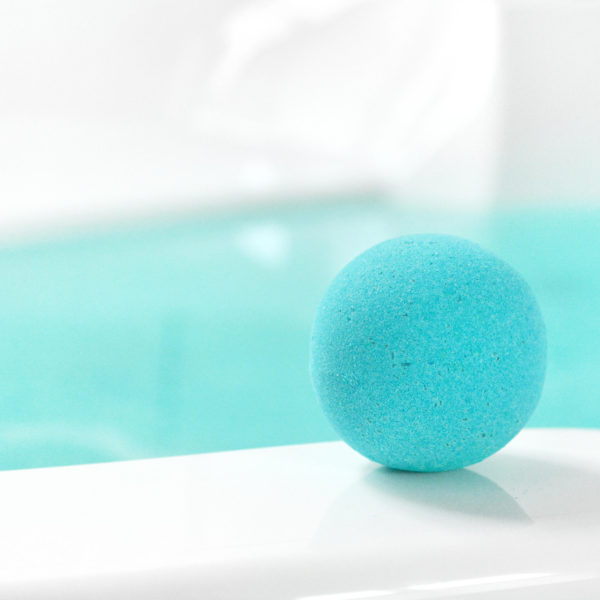 Teal Water Color Changing Soap & Bubbles Scented Bath Bomb by Tailored Soap in use